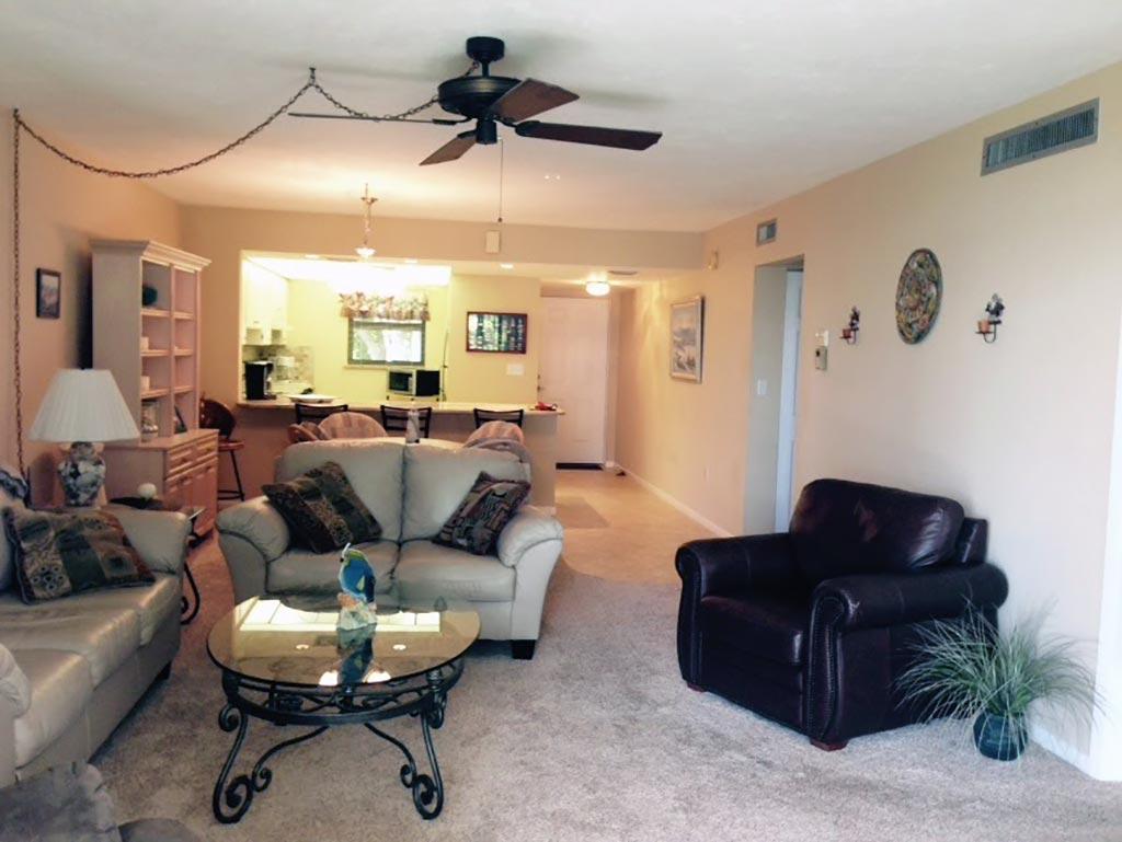 Florida condo livingroom view into kitchen