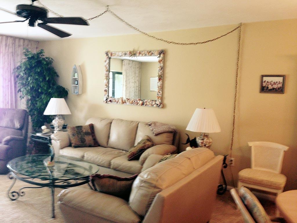 Florida condo livingroom includes plenty of seating